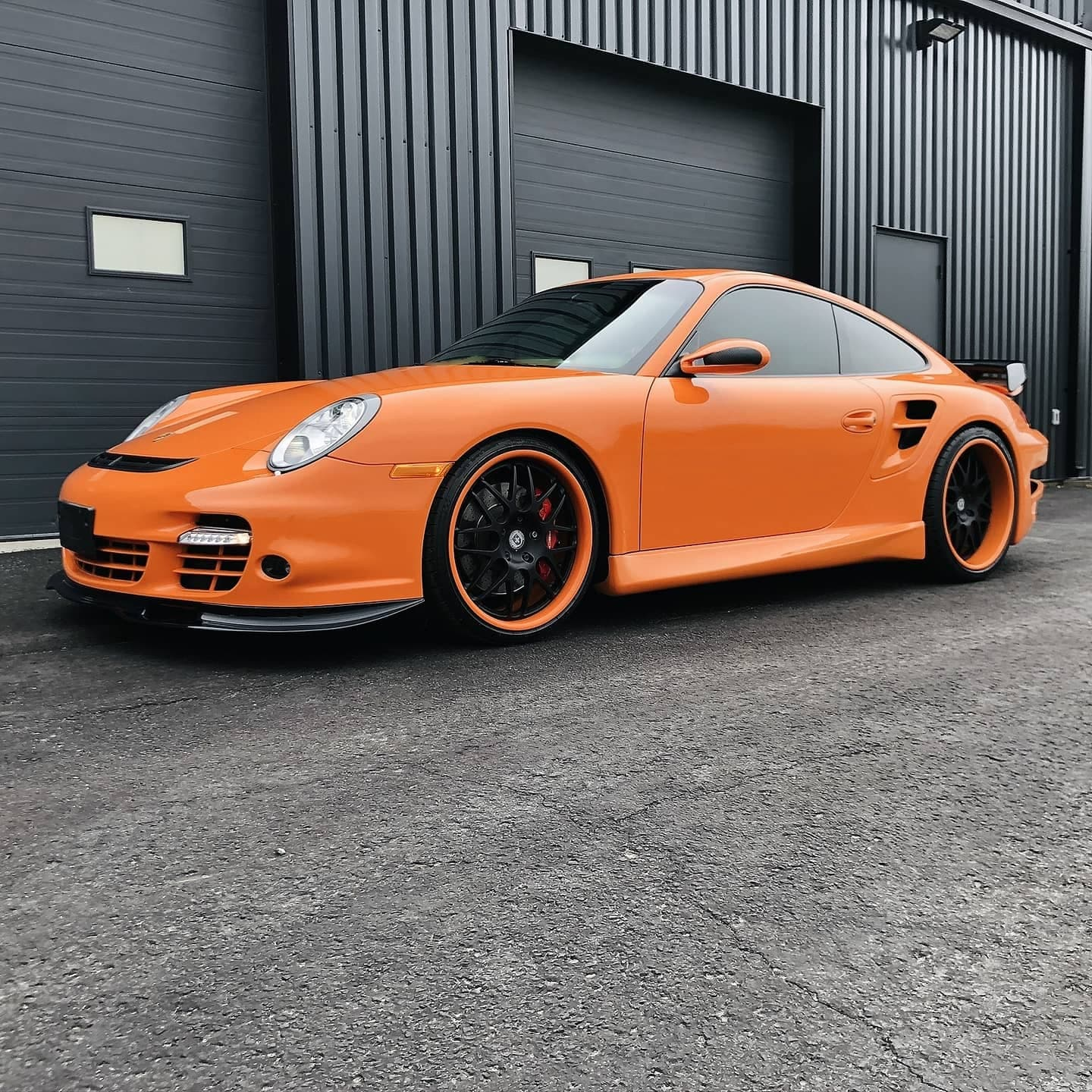 This is a photo of an orange porsche. Done at Autobuf fine car detailing and restyling in Kingston, Ontario