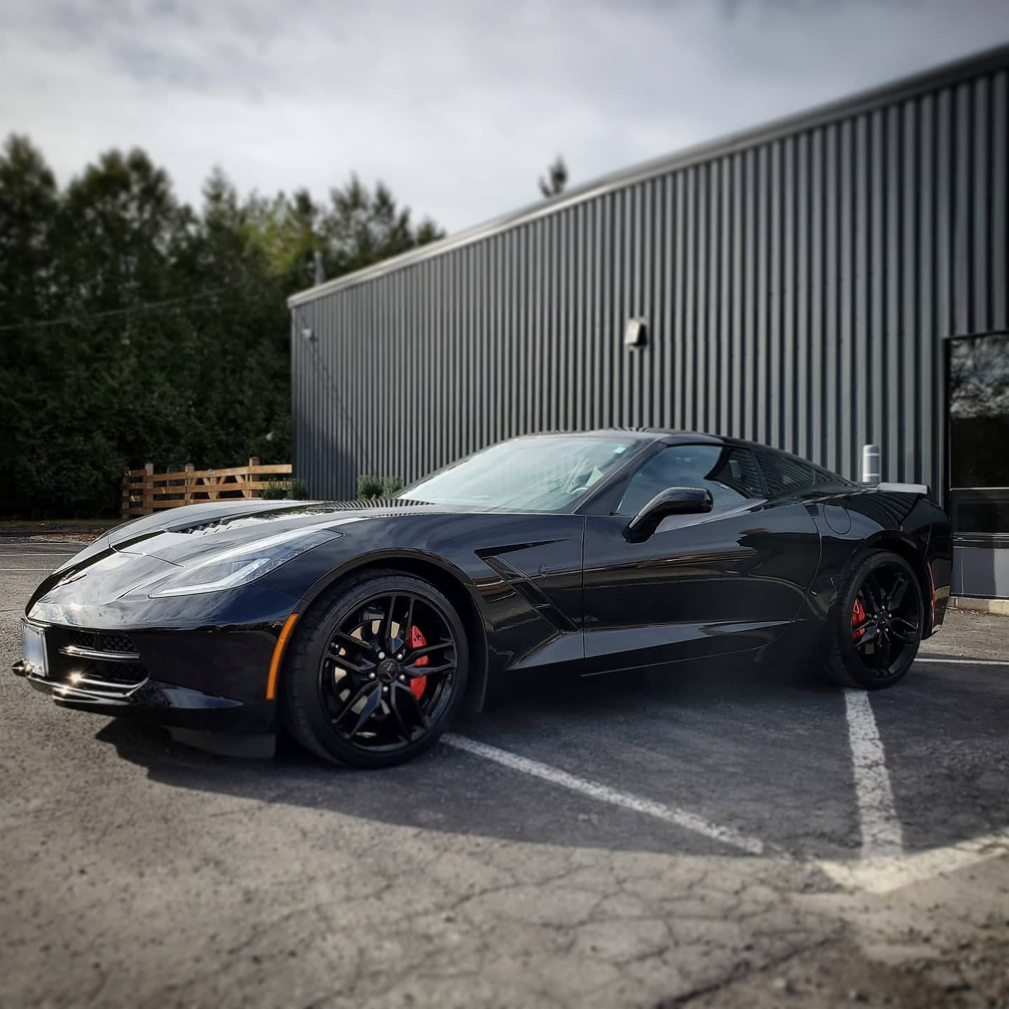 A black corvette at Autobuf fine car detailing and restyling in Kingston, Ontario