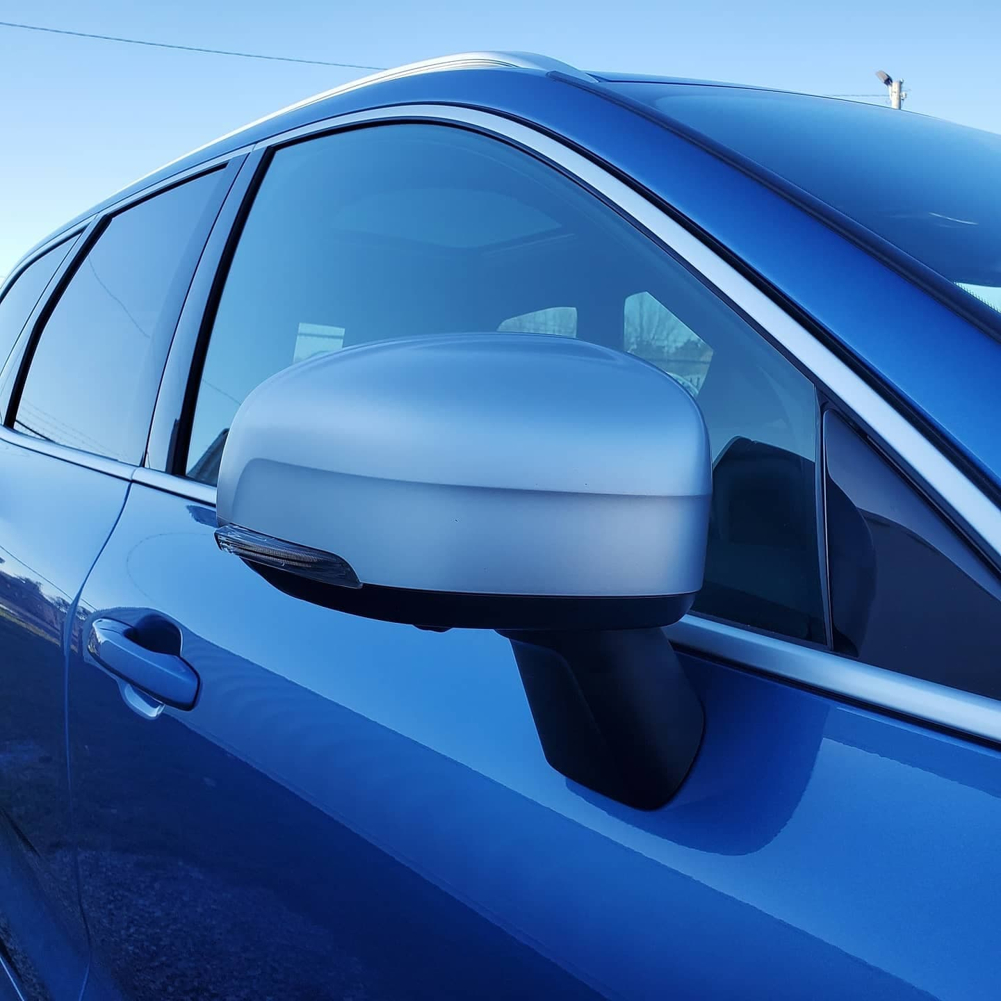 Blue car's mirror and window done at Autobuf fine car detailing and restyling in Kingston, Ontario